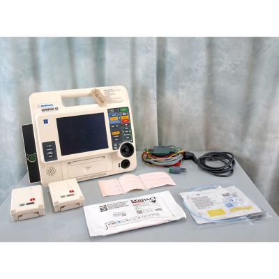 Physio Control Medtronic LifePak 12 with 2 Batteries , ECG & Therapy leads