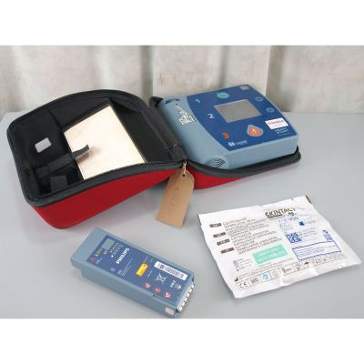 Laerdal Heartstart FR2+ AED Defibrillator with Battery (54%), 1 NEW Pack of Electrodes & Carry Bag